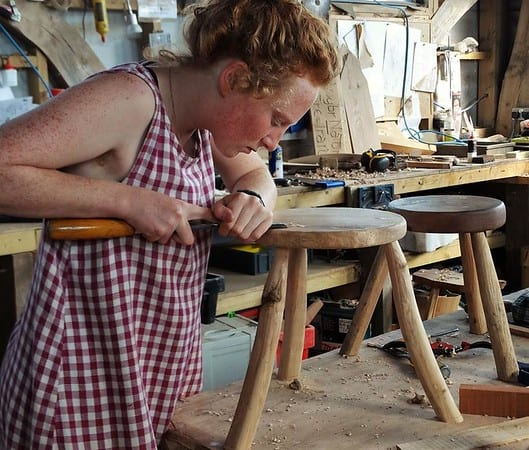 women carving wood